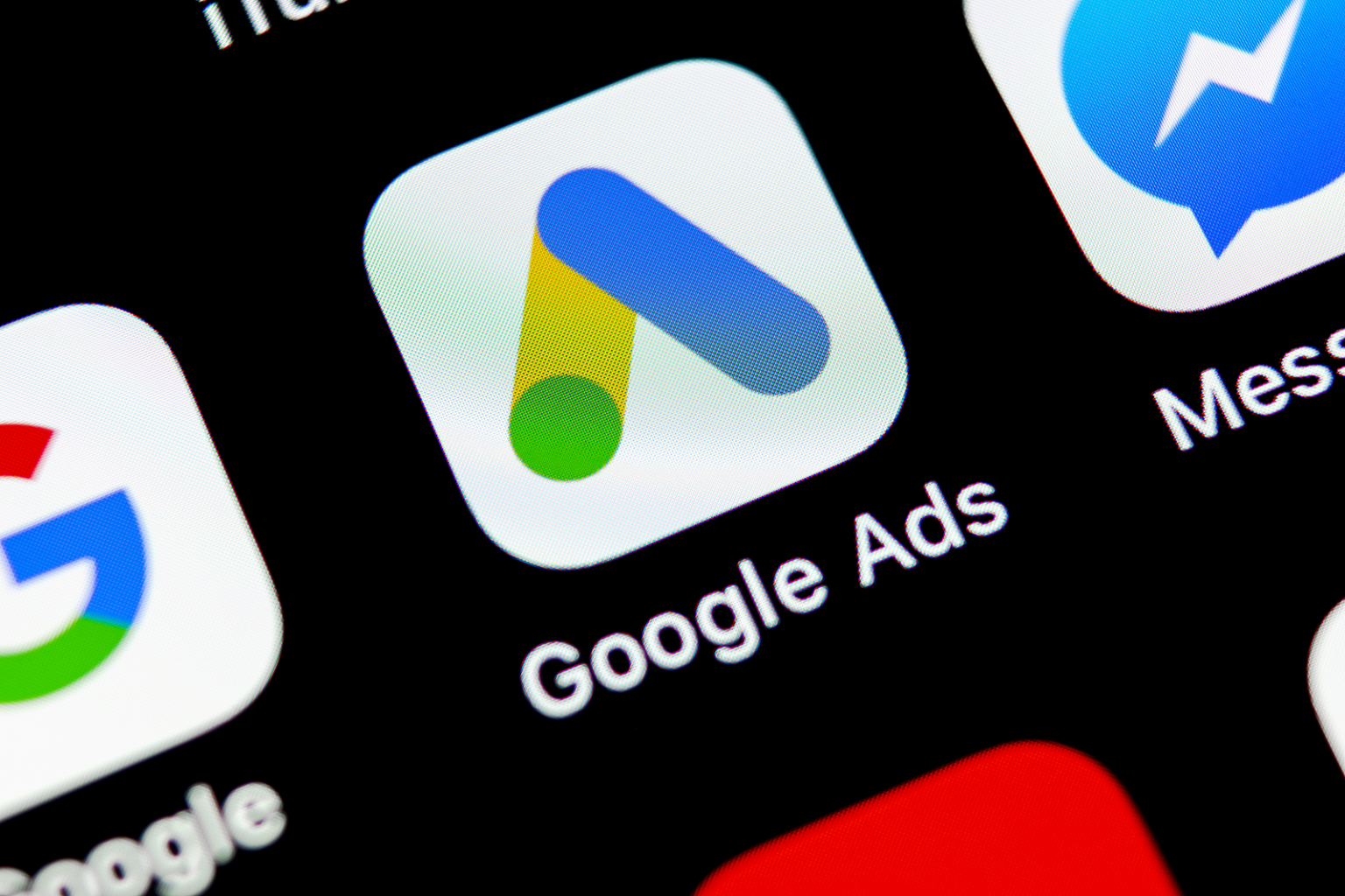The Google Ads app icon on a phone background.