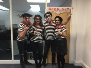 The design team dressed as French Kiss