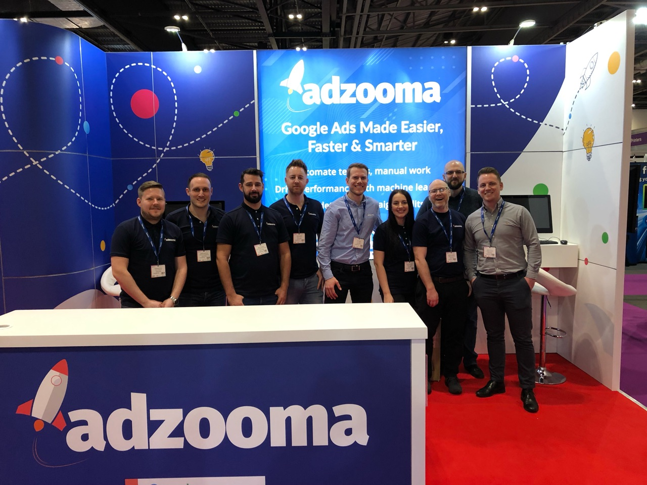 Image of the Adzooma stand and staff at the event