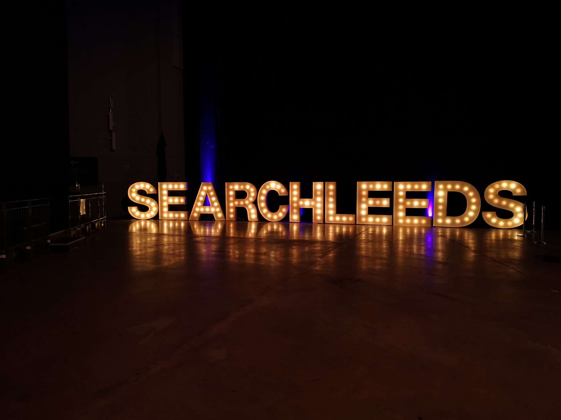 A photo of SEARCHLEEDS in lights.