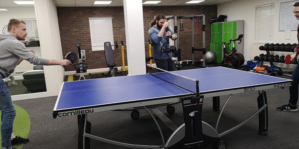 The guys were playing table tennis