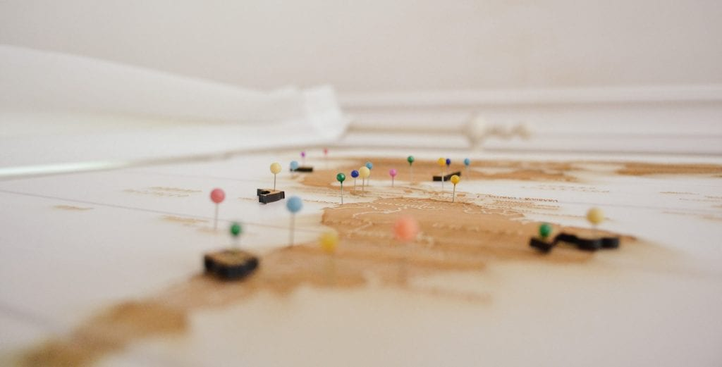 A map with pins in it.