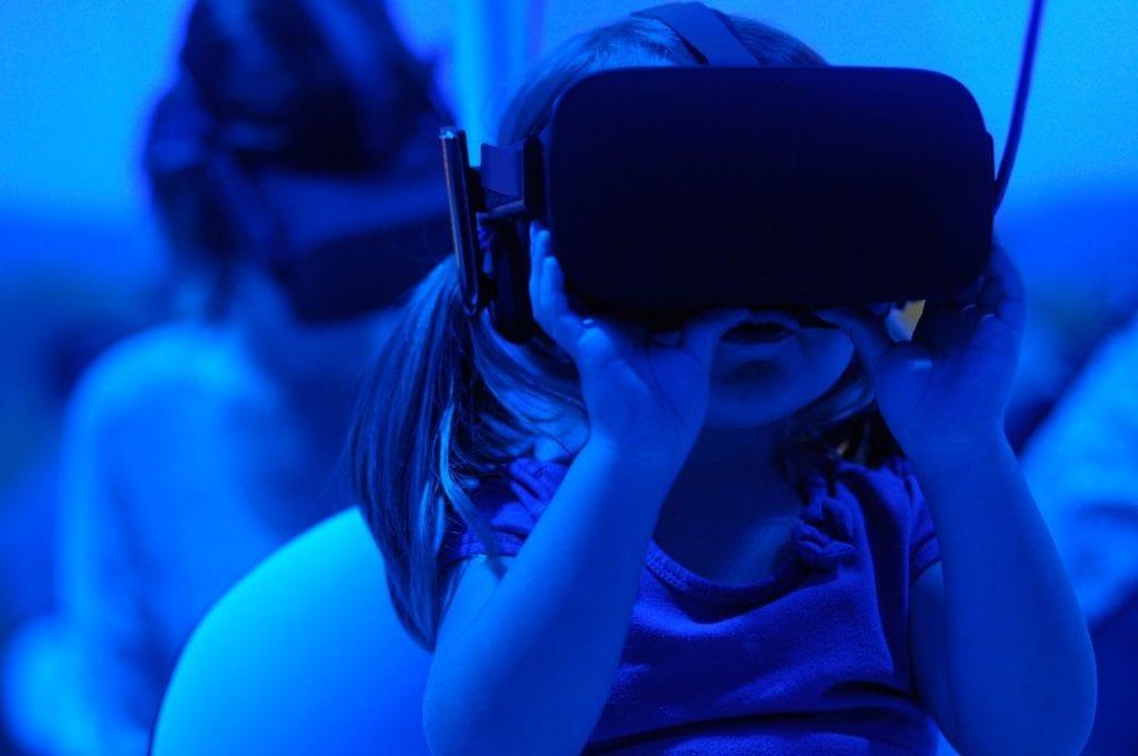 Little girl wearing a VR headset