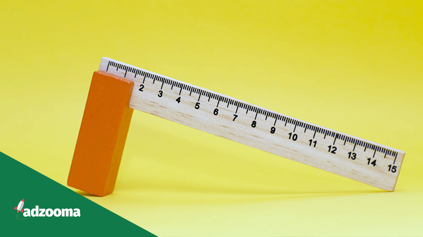 A wooden ruler on a yellow background