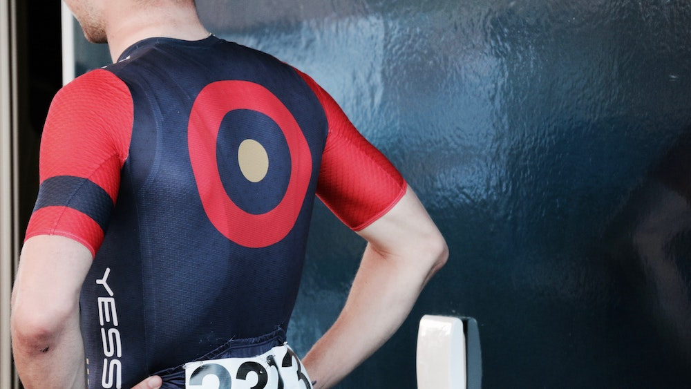 An athlete with a target on the back of his outfit