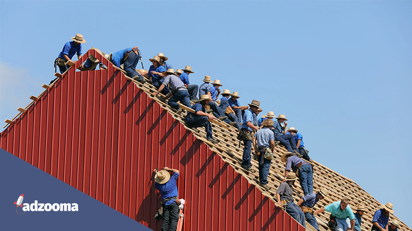 Workmen building a roof