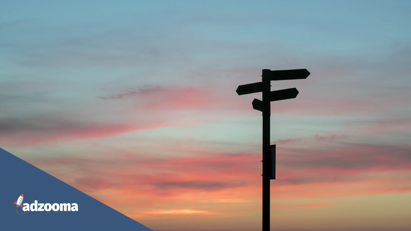 A silhouette of a signpost