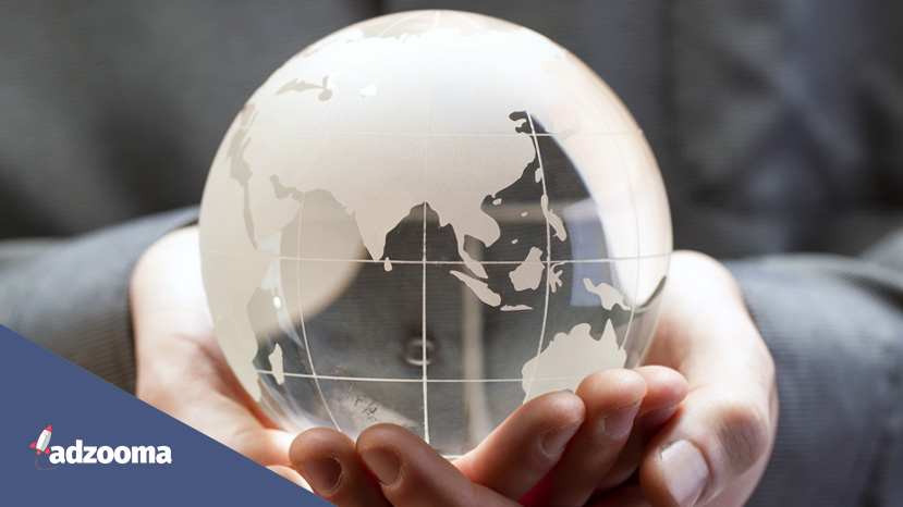 Someone holding a glass globe in their hands