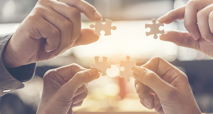 Implementation improving connections strategy team solution organization. Piece of jigsaw assembly by Implement puzzle. Hands of team connecting group of business people solutions success strategy